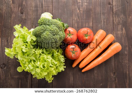 set of fresh vegetables on wood table - stock photo
