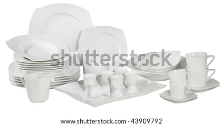 set of fresh washed plates and dishes isolated on white - stock photo