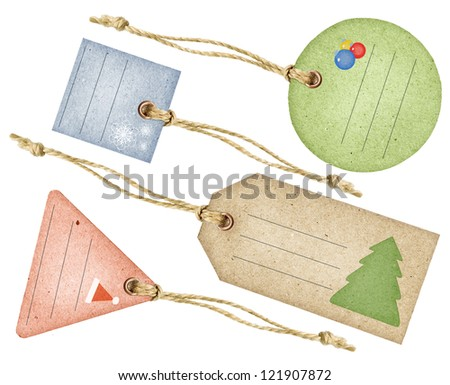 Set of funny Christmas aged paper tags with metal rivets and simple traditional strings, isolated over white background - stock photo