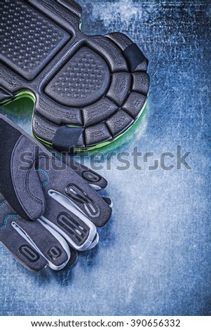 Set of gardening safety gloves knee protectors on metallic background agriculture concept. - stock photo