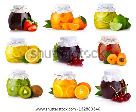 Set of glass jars with exotic fruits jam isolated on white - stock photo
