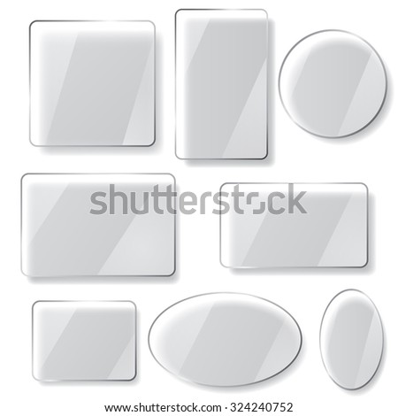 Set of glass plates of different shapes on white background - stock photo
