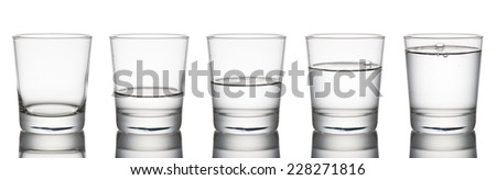 set of glasses from empty to full, on white background - stock photo