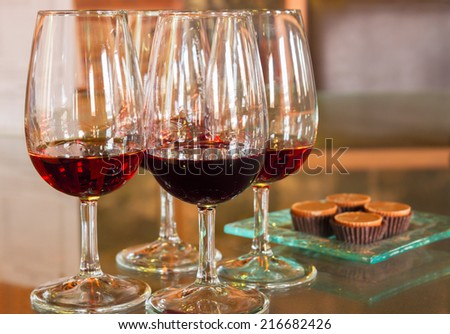 set of glasses of red ruby port wine - stock photo