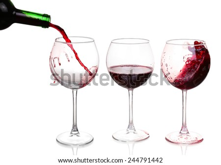 Set of glasses with red wine. In one of the glasses poured red wine - stock photo