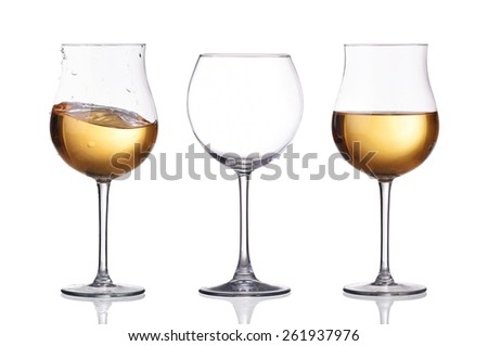 Set of glasses with white wine splash isolated on white - stock photo