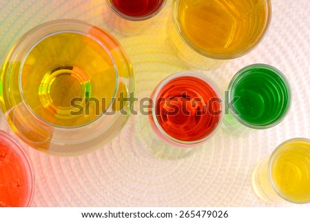 Set of glasses with wine and juice - stock photo