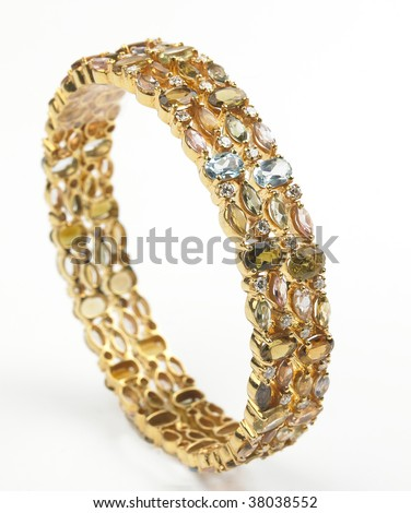 set of Gold bangles with diamonds - stock photo