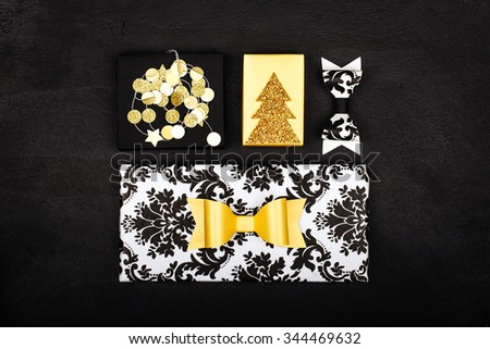 Set of gold, black and white gift boxes with bows, confetti  - stock photo