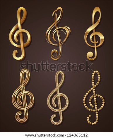 Set of golden decorative treble clef