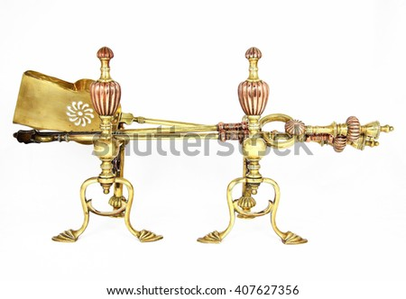 Set of graceful  antique Art Nouveau copper and brass fire irons with a poker, shovel and tongs on andiron stands over white