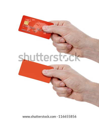 set of hands holding credit card and blank one - stock photo