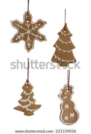 Set of Hanging Ginger Bread Cookies with white Decoration and in Different Shapes, Isolated on White - stock photo