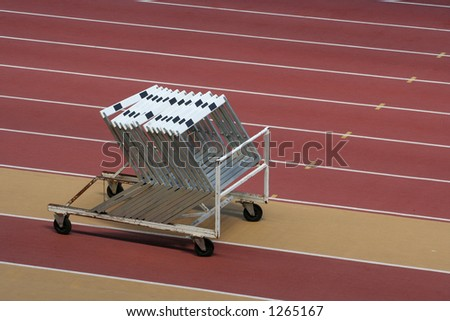 Set of hurdles in a stadium - stock photo