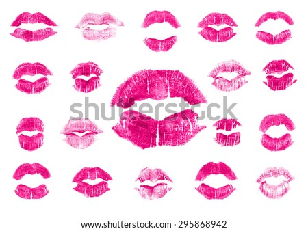 Set of 19 imprint of pink lipstick. Silhouettes of fuchsia lips isolated on white background. Qualitative trace of real lipstick texture. Can be used as a decorative element for print or design. - stock photo