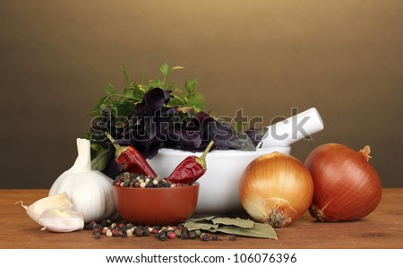 Set of ingredients and spice for cooking on wooden table on brown background - stock photo