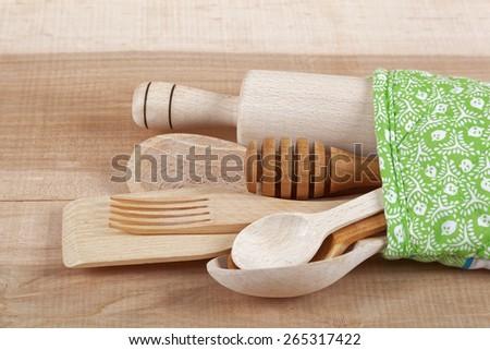 Set of kitchen utensils on wooden board. - stock photo