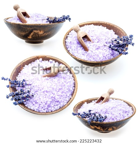 Set of lavender bath salt in bowl isolated on white background - stock photo