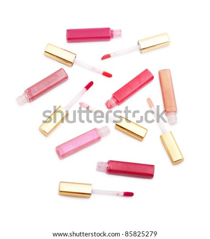 Set of lip glosses with different colours isolated on white - stock photo