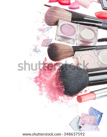 set of  make up brushes, lipsticks and  eye  shadows with crumbles  border isolated on white background