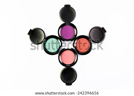 Set of 4 Make-up colorful eye shadows isolated on a white backgrownd. - stock photo