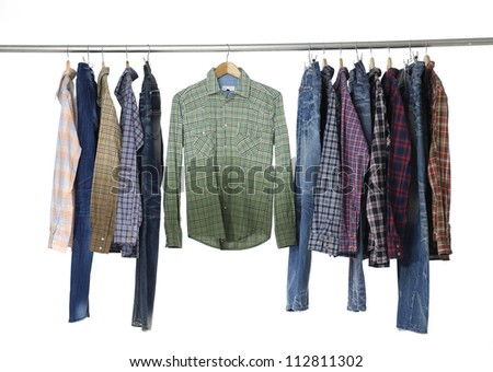 Set of men's different sleeved plaid cotton and jeans on a wooden hanger - stock photo