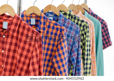 Set of men's different sleeved plaid cotton on hanger - stock photo