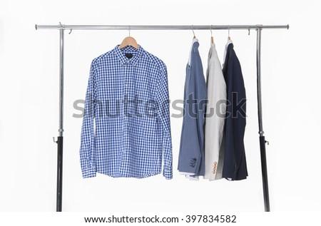Set of men's suits hanging  - stock photo