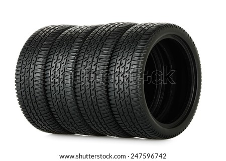 set of miniature tires isolated on white - stock photo