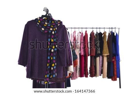 Set of Mix color f female clothing with coat on hanging