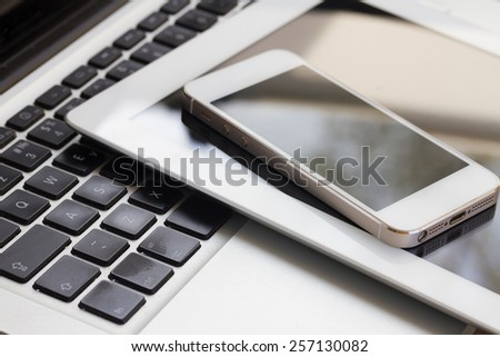 set of modern computer devices  - laptop, tablen and phone close up - stock photo