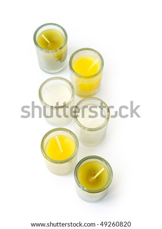 Set of multi-coloured candles in glass glasses - stock photo