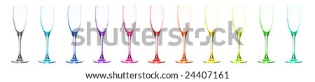 Set of multi-coloured glasses for champagne: red, orange, yellow, green, blue, dark blue, violet, pink, aquamarine, grey, citril. Over white.