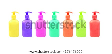 Set of multicolored cosmetic containers isolated on white background.