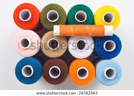 set of multicolored sewing spools - stock photo