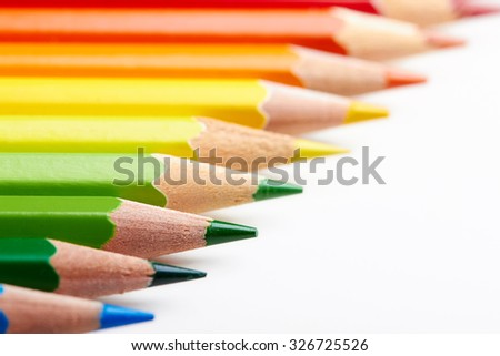 Set of multicoloured pencils lying on white table in row order. Creativity, art skill and school, variety of possibilities, game of imagination and fantasy, make world vivid and impressive concept - stock photo
