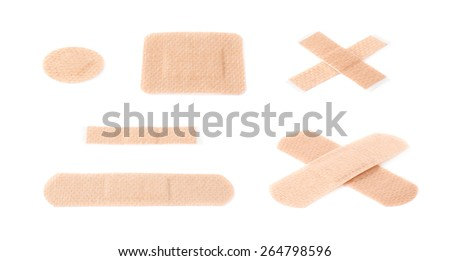 Set of multiple different adhesive bandage sticking plaster compositions isolated over the white background - stock photo