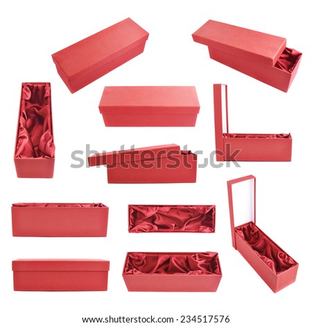 Set of multiple red tall gift boxes with the velvet cloth inside, isolated over the white background - stock photo