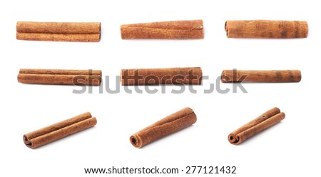 Set of multiple single cinnamon sticks isolated over the white background - stock photo