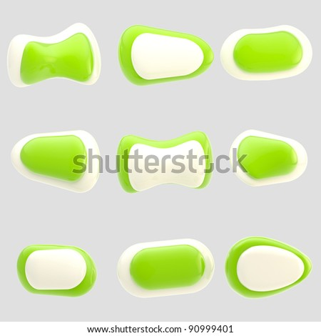 Set of nine glossy green and white plastic buttons isolated on grey