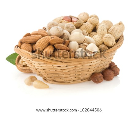 set of nuts in plate isolated on white background