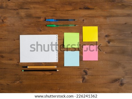Set of office supplies on old wooden table - stock photo