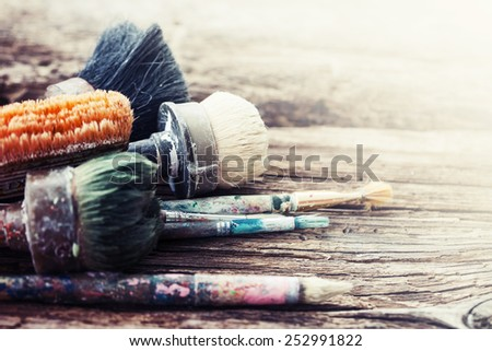 Set of old brush for coloring the walls/ Brush painting wooden furniture, close up/Paintbrush on wood background. - stock photo