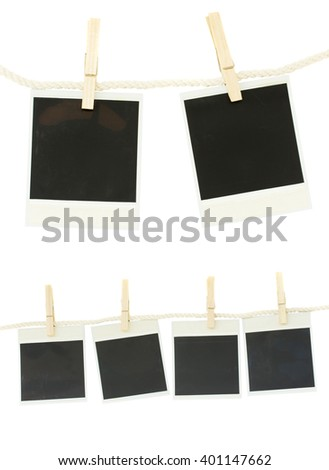 set of old fashioned photo papers hanging on rope isolated on white background