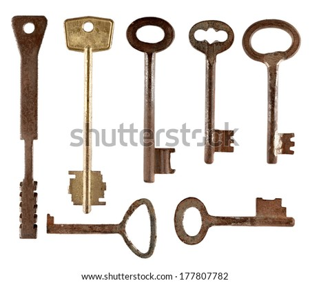 Set of old keys from door locks isolated on white background. - stock photo
