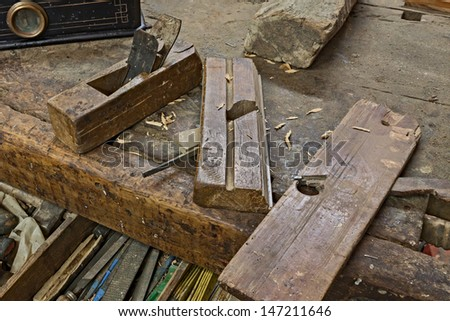 set of old planers on the carpenter's bench - ancient carpentry tools for woodworking  - stock photo