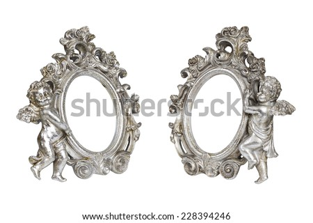Set of oval baroque silver picture frames with cupid isolated on white with clipping path. - stock photo