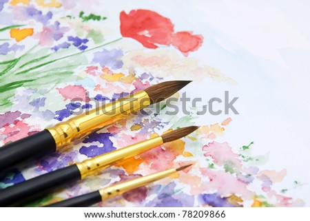 Set of Paint Brushes on Hand Drawn and Painted Watercolor Background - stock photo