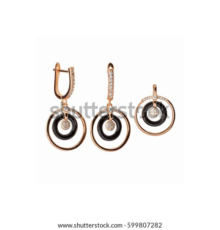 Set of pair gold and black earrings and pendant in form of rings with small fianits isolated on white background