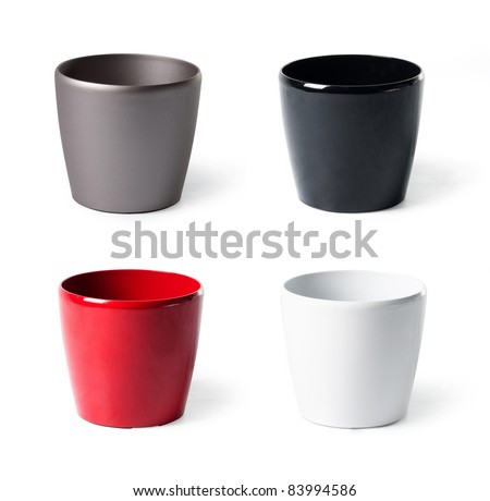 Set of plastic flowerpots for indoor plants on white background